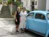 Elizabeth with Bernadette McDonald beside her favorite - and famous - car
